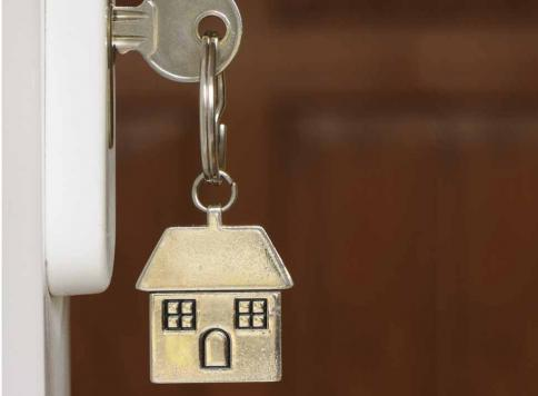 Key in lock with a house keyring